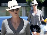 Hats off to her! Charlize Theron cuts a stylish figure in black mini skirt and ivory fedora on errand run