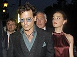 Coupled up: Johnny Depp and Amber Heard arrive at a restaurant in Moscow on Thursday night