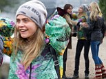 Having a model moment: Cara Delevingne and sister Poppy are ecstatic as they greet fellow clothes horse Alexa Chung at Glastonbury