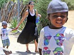 Sandra Bullock takes her 'little dictator' Louis on a fun day out at the Natural History Museum