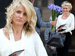 Windblown Cameron Diaz gets her hair in a tangle as she receives flowers on set of The Other Woman