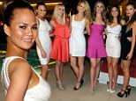 Sports Illustrated model Chrissy Teigen shows her sophisticated side in Sin City celebrating the Summer Of Swim