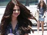 Swaying to the beat! Selena Gomez puts her luxurious locks and long legs on display after dance workout