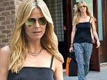 Chic-y! Heidi Klum shows off her assets in simple camisole and flowing leopard print trousers