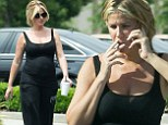 Pictured: Kim Zolciak STILL smoking after confirming she's pregnant with fifth child