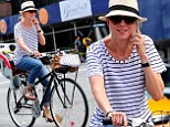 Multi-tasking mother! Naomi Watts glows as she rides her bicycle around NYC, carrying a heavy load and chit-chatting with a smile