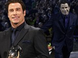 Making history: John Travolta accepted a Crystal Globe award for his outstanding artistic contribution during the opening ceremony of the 48th annual Karlovy Vary International Film Festival, in Karlovy Vary, Czech Republic on Friday