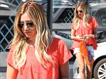 Feeling urban! Ashley Tisdale shows off her lean legs as she stocks up her summer wardrobe with an afternoon shopping spree