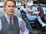 Newly blond Taylor Kitsch carries a bloody Jonathan Groff on the Manhattan set of HBO's The Normal Heart