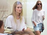 A short story! Rosie Huntington-Whiteley shows off her slim pins in a pair of tiny hotpants as she indulges in a mani-pedi