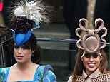 Eugenie (in a Vivienne Westwood dress and Philip Treacy hat) and Beatrice (in a Treacy fascinator) at the Royal Wedding in 2011