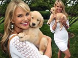 Puppy love! Christie Brinkley cuddles up to an adorable pup as she crowned a 'pet hero'