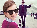 'Love locks in Paris!' Emma Roberts plays the part of goofy tourist in the City Of Light