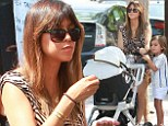 Kourtney Kardashian, 34, and her three-year-old son Mason sported identical puckers on Saturday during a family outing to a farmer's market in Los Angeles