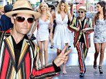 It's show time! Corey Feldman makes a splashy entrance surrounded by his 'Angels' at fashion launch