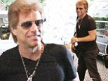 Still keeping the faith! Jon Bon Jovi beams out a smile as he arrives in Milan ahead of band's concert