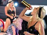 That's totally gross! Kesha gets wild with whipping cream as she douses herself and her dancer at music festival