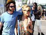 Love is in the air! Sienna Miller cosies up to Tom Sturridge and Peaches Geldof shares a warm embrace with Thomas Cohen as they lead celeb couples at Glastonbury