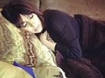 'I love my lil baby so much': Khloe Kardashian posted this picture of her dog napping with her sister Kim to Facebook