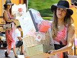 Hat's off to her! Jessica Alba styles out the California heatwave in wide-brimmed hat and flowing orange dress