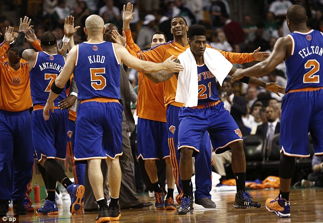 On top: Anthony (7), Jason Kidd (5) and Raymond Felton (2) are congratulated by teammates including Iman Shumpert (21)