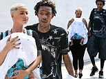 Amber Rose and Wiz Khalifa behave themselves as they take their little man on a stroll (after turning BET red carpet blue)