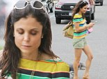 Skinnygirl Bethenny Frankel shows off her slender legs in tiny shorts while walking her dog