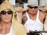 Going casual: Mickey Rourke dressed very comfortably for his pizza in Beverly Hills