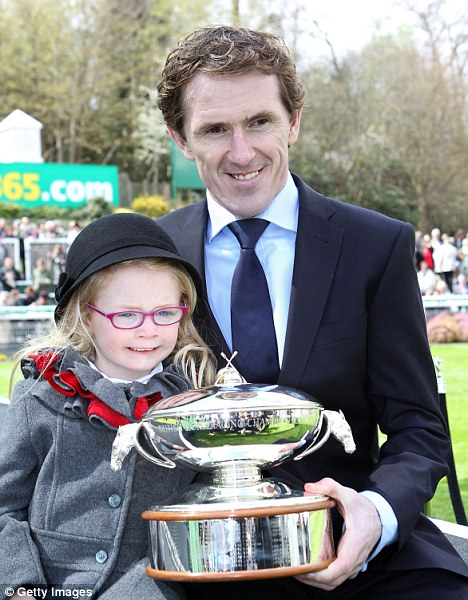 Silver service: McCoy and daughter, Eve, with his trophy