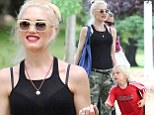 Bra-vissimo! Gwen Stefani shows a hint of her underwear through edgy black vest as indulges her fierce side in camouflage