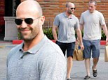 Boys just want to have fun! Jason Statham and friend stock up on booze ahead of Independence Day celebrations