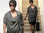 It's growing so fast! Pregnant halle Berry shows her baby belly in a draping tunic as she steps out in Los Angeles, California on Wednesday