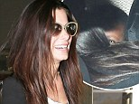 Happy to be home: Sandra Bullock was delighted to be re-united with her son Louis
