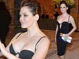 Too revealing? Corset's not! Rose McGowan sports a low-cut LBD for Fendi event in Paris