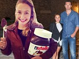Easy, there are 27,000 calories in that! Wide-eyed Hayden Panettiere cradles monster 5kg tub of Nutella on holiday