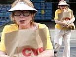 Not an ad-visor-able look: Shirley MacLaine, 79, sports youthful sun-shielding headwear on outing to the shop