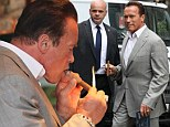 Try before you buy! Arnold Schwarzenegger visits a cigar shop in London