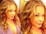 Look at me now! 'Having a bit of fun today. (sic) Big hair, minimal wardrobe!' LeAnn Rimes tweeted on Tuesday