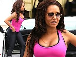There's an eyeful! Mel B busts out the overflowing cleavage in tight pink top during outing with friends