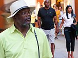 Vacation buddies! Samuel Jackson and Magic Johnson pal around the island of Capri as their wives shop for designer clothes