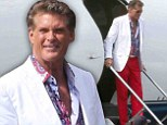 Hoff style: David Hasselhoff brightened up the Los Angeles set of Stretch on Tuesday in red trousers, white sports coat and garish multi-coloured open-collared shirt