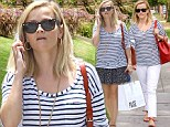 Twice the fun: Reese Witherspoon started her Tuesday in Brentwood, California by wearing a floral skirt and later changed into a pair of white trousers
