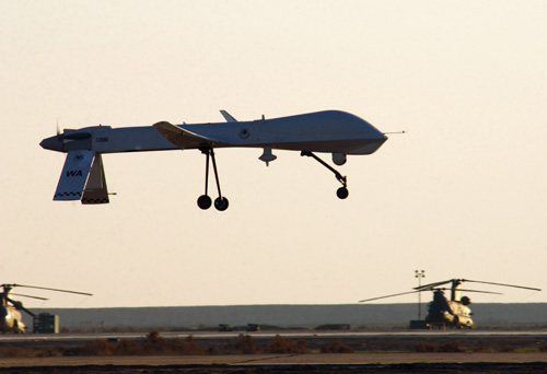 MQ-1 Predator UAS: A US Air Force (USAF) MQ-1 Predator assigned to the 46th Expeditionary Reconnaissance Squadron (ERS), lands at Tallil Air Base (AB), Iraq, in support of OPERATION IRAQI FREEDOM. The Predator is a remotely piloted Umanned Aerial Vehicle (UAV) that provides real-time surveillance imagery.