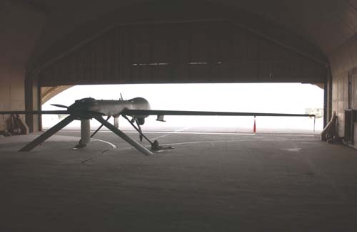 "MQ-1 Predator UAS: An MQ-1 Predator unmanned aerial vehicle is stored between missions in the cool space of a hardened aircraft shelter at Balad Air Base, Iraq, on July 31. With flying missions that last an average of 20 hours, Airmen from the 46th Expeditionary Reconnaissance Squadron provide ground commanders ""persistant stare"" by following suspected insurgent activities for long periods of time. (U.S. Air Force photo/Senior Airman Jim Croxon)"