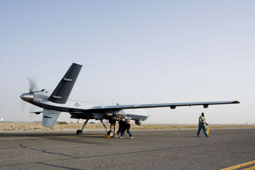 MQ-1 Predator UAS: Aircrews perform a preflight check on an MQ-9 Reaper before it takes off for a mission in Afghanistan. The Reaper is larger and more heavily-armed than the MQ-1 Predator and in addition to its traditional ISR capabilities, is designed to attack time-sensitive targets with persistence and precision. (Courtesy photo)