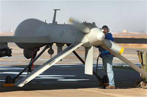 MQ-1 Predator UAS: Bruce Ottenwess conducts pre-flight checks before launching the MQ-1 Predator Unmanned Aerial Vehicle recently from Balad Air Base, Iraq. Mr. Ottenwess is a General Atomics Aeronautical Systems Airframe and power plant mechanic based out of Creech Air Force Base, Nev. (U.S. Air Force photo/Staff Sgt. Michael R. Holzworth)