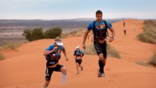 Matt Donovan leads Matty Abel during the 250km Big Red Run through the Simpson Desert.