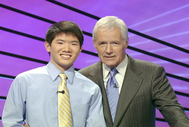 Kentridge's Christian Ie stands with Jeopardy host Alex Trebek. - Contributed