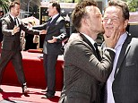 Breaking Bad's Bryan Cranston gets congratulatory kiss from co-star Aaron Paul at his Hollywood Walk of Fame ceremony