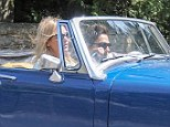 Zoom zoom: Kate was hardly going incognito in her stand-out sports car, whizzing through the village